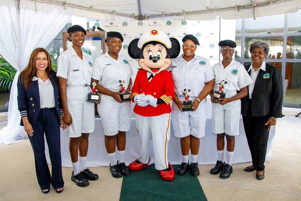 L-R: Yvonne Sweeney, VP Human Resources, Disney Cruise Line; Greene, Cadet Paula Greene; Cadet Christina Adderley; Captain Minnie Mouse; Cadet Antonique Lightbourn; Cadet Emily Bain and Dr. Brenda Cleare, LJM President during a special award ceremony held at the LJM Maritime Academy in Nassau Friday March 6, 2020 (Photo by Tim Aylen)